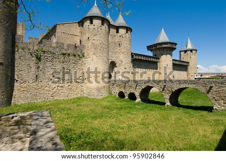 View of Ancient chateau and moat in Carcassonne Chateau. Carcassone is a fortified chateau in France. It was added to the UNESCO list of World Heritage Sites in 1997. - stock photo