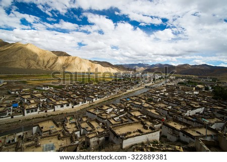 View of ancient Tingri town from Shegar Dzong (Chode Monastery) - stock photo