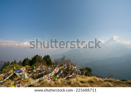 View of Annapurna and Dhaulagiri mountains range from Poon hill, Nepal. Poon hill is a part of Annapurna Sanctuary trek, one of the most popular adventure circuit trek in the world. - stock photo