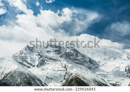 View of Annapurna II mountain, 7,937 m (26,040 ft). Nepal, Himalayas. Annapurna II is a part of Annapurna circuit trek, one of the most popular adventure circuit trek in the world. - stock photo