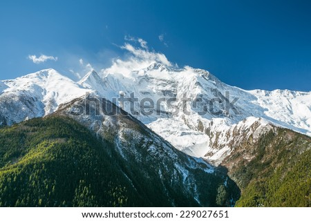 View of Annapurna II mountain, 7,937 m (26,040 ft). Nepal, Himalayas. Annapurna II is a part of Annapurna circuit trek, one of the most popular adventure circuit trek in the world.