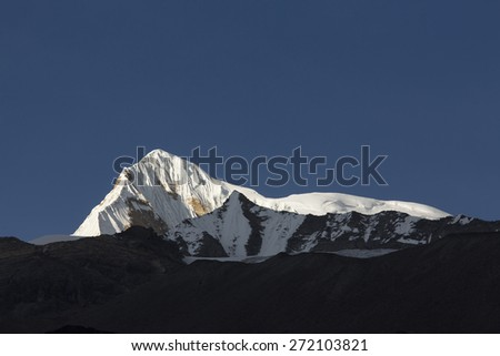 View of Annapurna South from Annapurna Base Camp Himalaya Mountains in Nepal at sunrise - stock photo