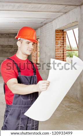 view of architect looking comparing housing project with building - stock photo