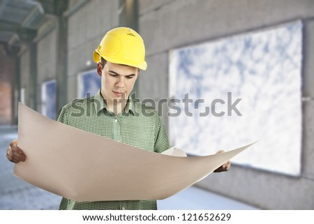 view of architect looking comparing housing project with building