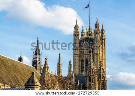 View of Architectural details of Palace of Westminster (known as Houses of Parliament) located on bank of River Thames in City of Westminster, London. Victoria Tower. - stock photo