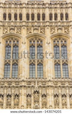View of Architectural details of Victoria Tower - largest and tallest (98 m) tower of Palace of Westminster. Palace of Westminster (or Houses of Parliament) located in City of Westminster, London. - stock photo