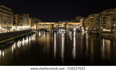 view of Arno river and Ponte Vecchio in Florence, Italy