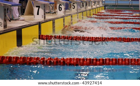 View of athletes competing in swimming race - stock photo