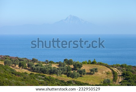 View of Athos Mountain from Sithonia peninsula,Northern Greece - stock photo