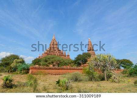 View of Bagan temples, Myanmar. Bagan is ancient city with thousands of ancient temples and stupas. It is seen by many as equal in attraction to Angkor Wat. - stock photo