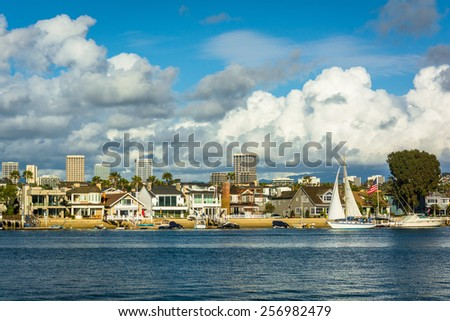 View of Balboa Island, and buildings in Irvine, from Newport Beach, California. - stock photo