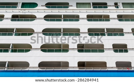 View of balconies and side of a luxury cruise ship in the Caribbean