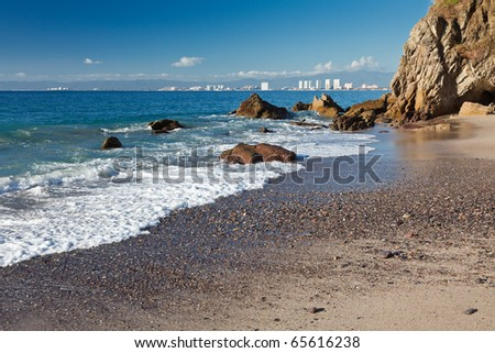 View of Banderas Bay and Puerto Vallarta from a wild beach - stock photo