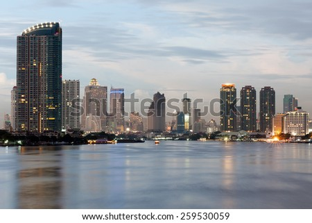 View of Bangkok  city from Krungthep bridge in the middle of Chao Phraya river.