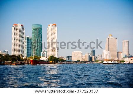 View of Bangkok seen from Chao Phraya river - stock photo