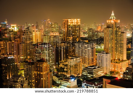 View of Bangkok skyline in the night. This picture was taken at the commercial center of Bangkok, Thailand. - stock photo