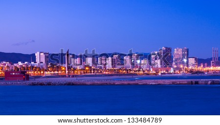 View of Barcelona from sea side in night. Catalonia, Spain
