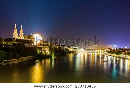 View of Basel over the Rhine by night - Switzerland - stock photo