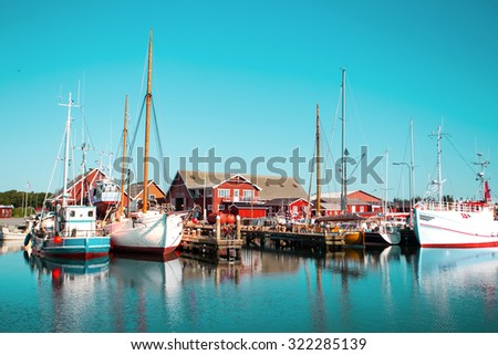 View of bay of morning in a small Swedish town, Sweden. houses and ships against the sky
