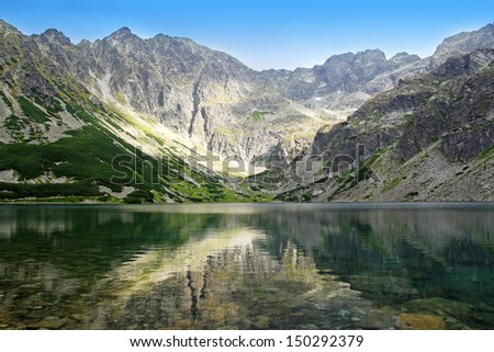 view of beautiful Black Pond Gasienicowy in Tatra Mountains, Poland - stock photo