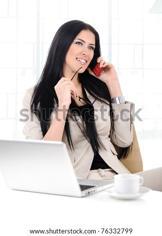 View of beautiful business woman holding cell phone and talking