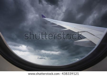 View of beautiful cloud and wing of airplane from inside window