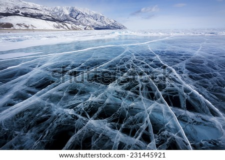 View of beautiful drawings on ice from cracks and bubbles of deep gas on surface of Baikal lake in winter, Russia - stock photo