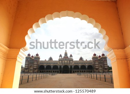 View of beautiful & historical mysore palace from an arch. The palace is a historic monument located in mysore in south karnataka, India and is a huge tourist attraction. - stock photo