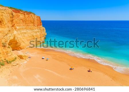 View of beautiful sandy Benagil beach and azure sea water in Algarve region, Portugal - stock photo