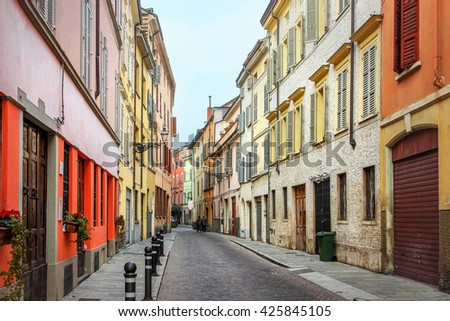 View of beautiful street with colorful houses in Parma, Emilia-Romagna province, Italy. - stock photo