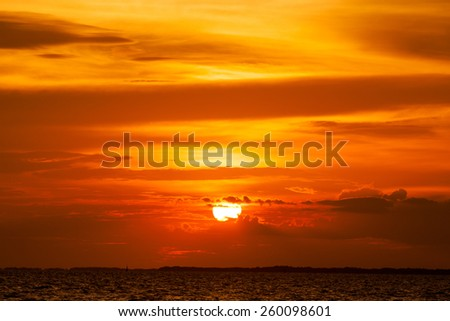 view of beautiful sunset above the sea. - stock photo