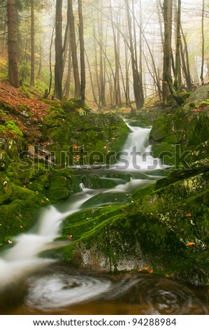 View of beautiful waterfall during the daytime. - stock photo