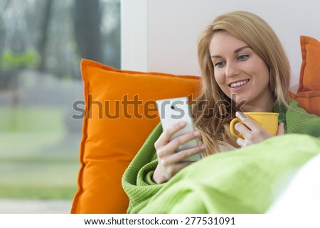 View of beautiful woman with mobile phone - stock photo