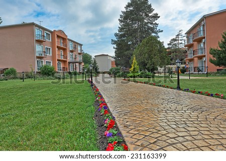 View of beautifully residential yard and arranged flower garden in Anapa, Russia  - stock photo