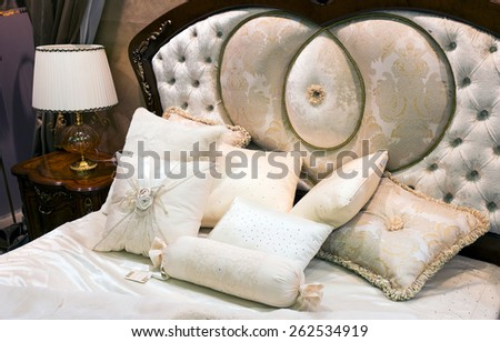 View of bedroom with bed in baroque style - stock photo