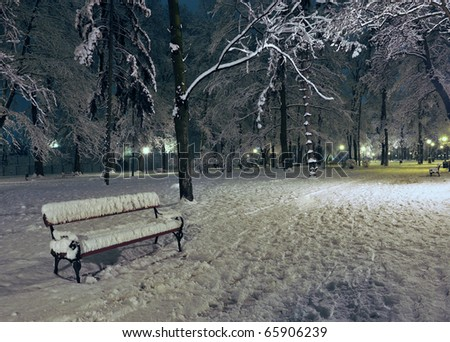 View of bench and shining lantern - stock photo