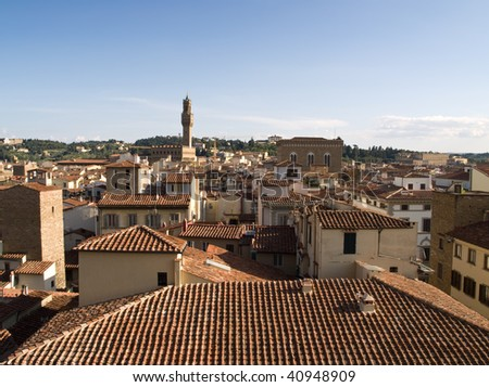 View of beutiful red rooftops in Florence shot from Campanile. - stock photo