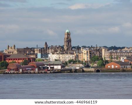 View of Birkenhead skyline across the Mersey river in Liverpool, UK - stock photo
