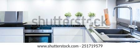 View of black and white kitchen interior - stock photo