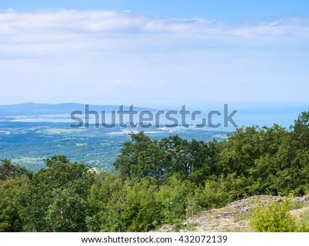 view of Black Sea coast with Primorsko and Sozopol towns from Strandzha mountain, Bulgaria - stock photo