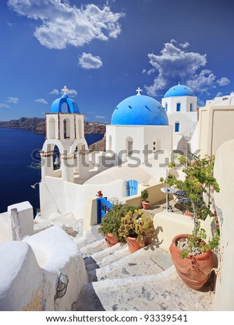 View of blue dome church in Oia village on Santorini island, Greece - stock photo