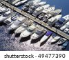 View of boats moored on Monaco jetty - stock photo