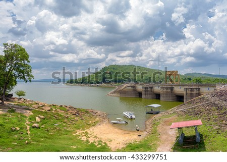 view of boats park at front of Ubonrat Dam, khonkaen, Thailand.Show low level water because of drought. - stock photo