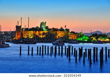 View of Bodrum harbor and Castle of St. Peter after sunset. Turkish Riviera. - stock photo