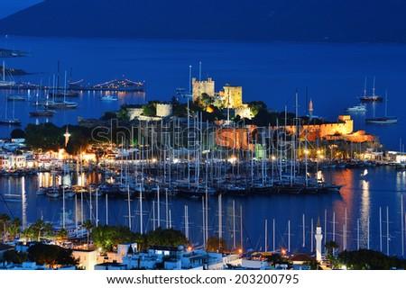View of Bodrum marina by night. Turkish Riviera. - stock photo