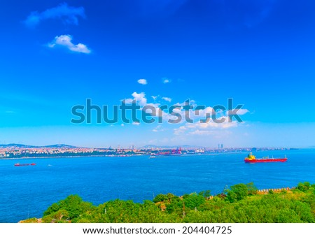 view of Bosphorus channel from the famous Topkapi palace at Istanbul in Turkey. Some ships cross the channel. - stock photo
