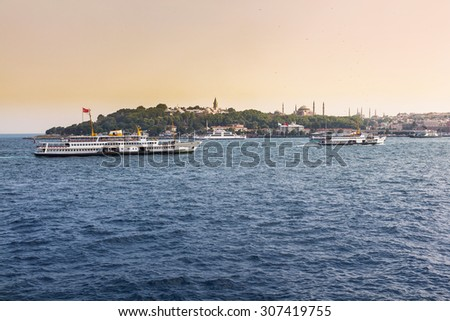 View of bosphorus with hagia sophia, blue mosque and topkapi palace from sea - stock photo