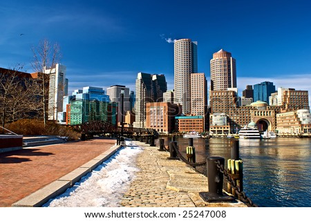 view of boston harbor and rowes wharf and skyscraper buildings in boston massachusetts - stock photo