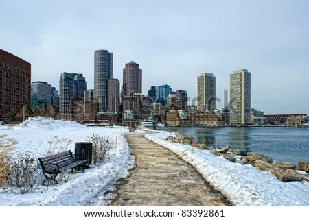 view of boston harbor and rowes wharf and skyscraper buildings in south boston massachusetts in winter. - stock photo