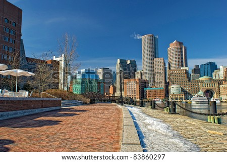 View of Boston skyline and rowe's wharf with skyscraper buildings during winter - stock photo